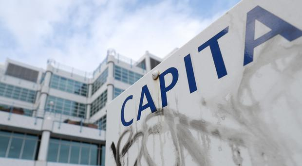 Capita has insisted its overhaul is on track but has 'some way to go' as it reported a 26% fall in annual profits (Andrew Matthews/PA)