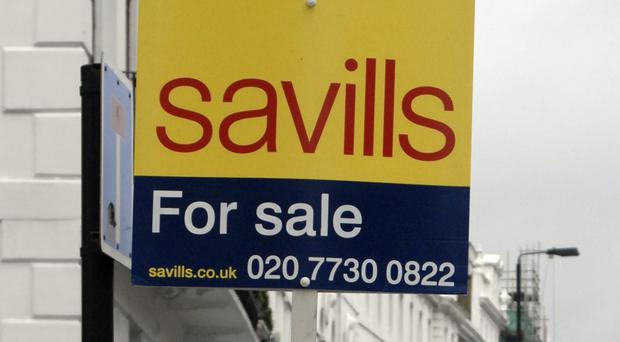 A general view of a Savills For Sale sign in London. Savills posted a slight drop in annual profits.