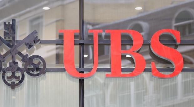 The FCA has fined UBS £27.6 million (PA)