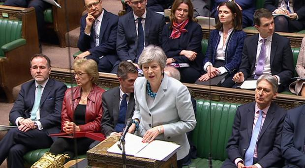 The pound was hit by further Brexit uncertainty as the Prime Minister postponed a vote on her proposed deal (House of Commons/PA)