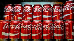 Coca-Cola reported a 24% rise in earnings per share (Nick Ansell/PA)