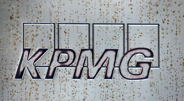 KPMG has revealed plans to restructure its audit arm (Philip Toscano/PA)