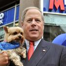 Founder and Vice Chairman Vernon Hill II with his dog Duffy, outside the newly opened Metro Bank branch in Holborn, central London.