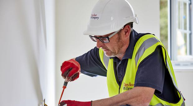 Construction output contracted for the third time this year in May (Taylor Wimpey/PA)