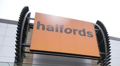 Halfords profits were hit by weaker demand and the cost of its new strategy (Yui Mok/PA)