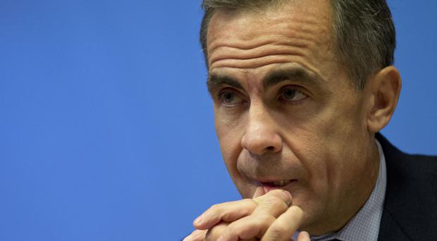 Bank of England Governor Mark Carney announced that interest rates will stay at 0.75% (PA)