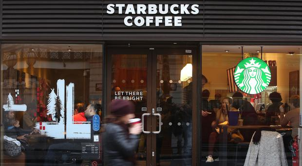 Starbucks saw its tax bill for the year rise despite posting the loss (Philip Toscano/PA)