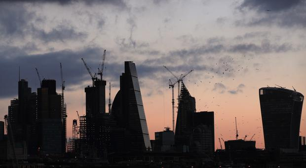 A view of the City of London skyline before sunset