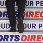 Sports Direct branding on the stairs of the company headquarters in Shirebrook, Nottinghamshire (PA)