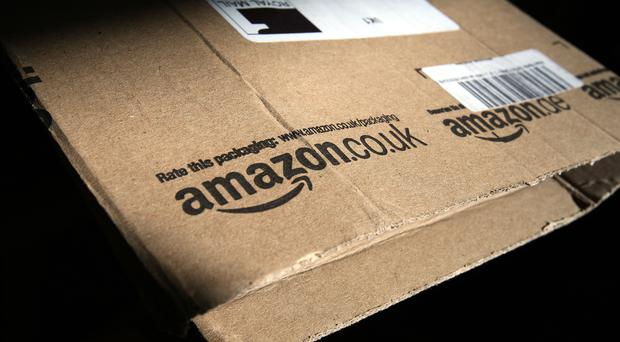 Amazon said net sales in the recent quarter rose 20% (Paul Faith/PA)