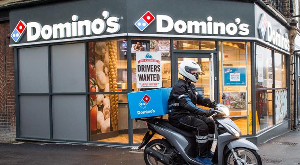 Domino's Pizza Group's (DOM) Sell Rating Reiterated at UBS Group