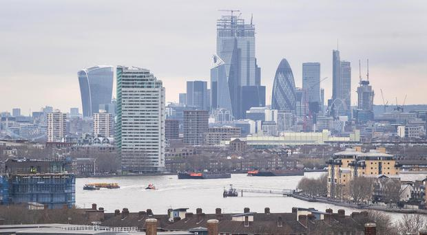 General view of the City from Greenwich Park, south London. The London markets closed higher as traders welcomed positive Chinese trade data as its tensions with the US continued to cool (PA)