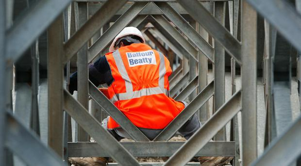 UK infrastructure giant Balfour Beatty's turnaround has continued to gather pace, as the firm boosted profits by more than a quarter in the first half of the year (PA)