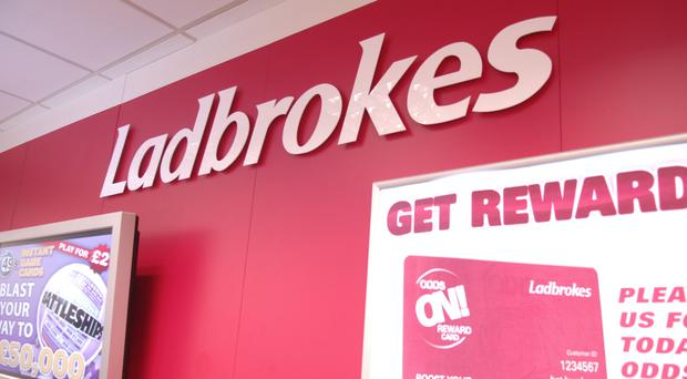 Ladbrokes owner GVC pushed its profit forecasts higher as its UK high street stores performed better than expected (Ladbrokes/PA)