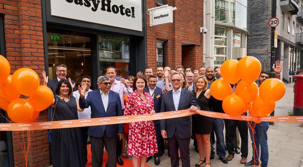 Guy Parsons, CEO of easyHotel (front right) and Kate Nichols, CEO of UK Hospitality (front left), cutting a ribbon at the opening of a new easyHotel in Old Street (Professional Images/PA)