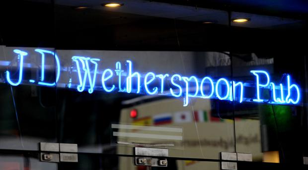 JD Wetherspoon reported falling annual profits in the face of higher costs, but cheered a hike in sales as pub-goers shrugged off Brexit uncertainty (PA)