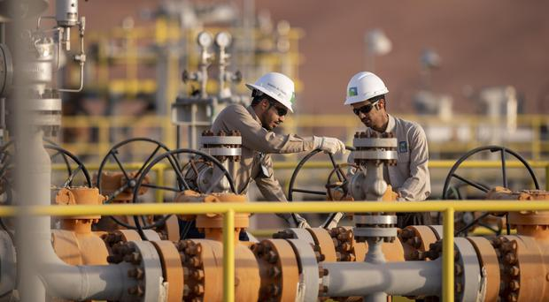 Workers on a Aramco site (Aramco / PA)