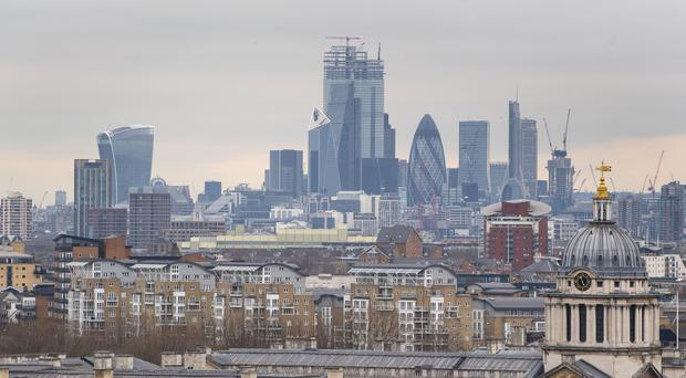 City traders endured another dismal day as the FTSE 100 tumbled into the red amid concerns of a global economic slowdown (PA)