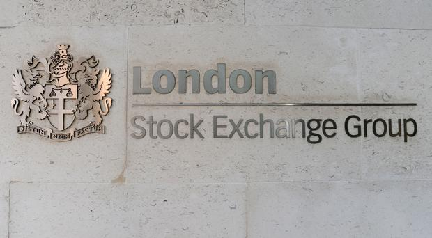 London Stock Exchange finance chief David Warren has announced his retirement (Nick Ansell/PA)