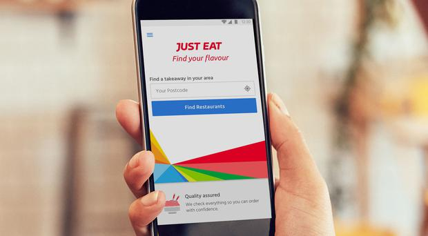 Just Eat is at the centre of a bidding war after investment firm Prosus announced a £4.9bn bid to buy the food delivery group, months after it agreed a merger with Dutch rival Takeaway.com (JustEat/PA)