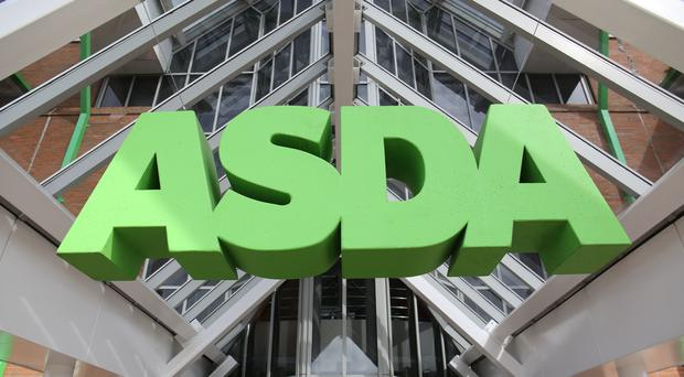 File photo dated 01/05/15 of an Asda sign.