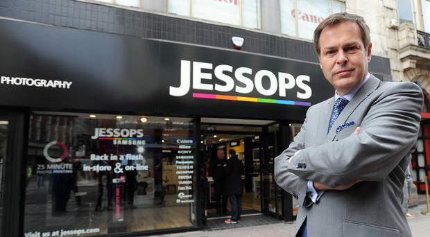 Dragon's Den star Peter Jones has delayed the planned restructuring of camera chain Jessops by two weeks as he thrashes out a rescue deal with landlords of high street stores.
