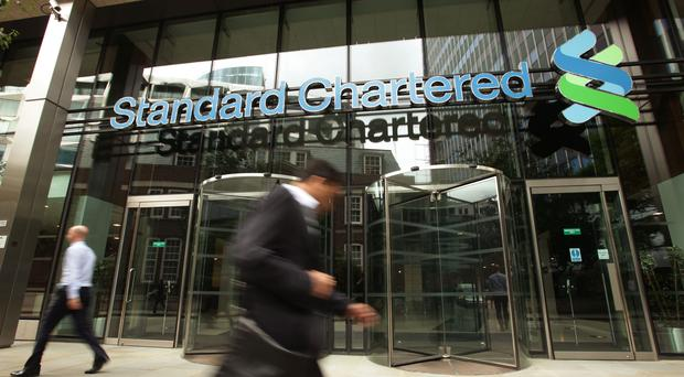 Standard Chartered has shrugged off protests in Hong Kong and a slowdown in the global economy to post a hike in third-quarter profits (PA)