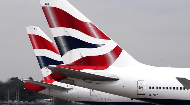 British Airways owner IAG posted increased passenger numbers in October (PA)