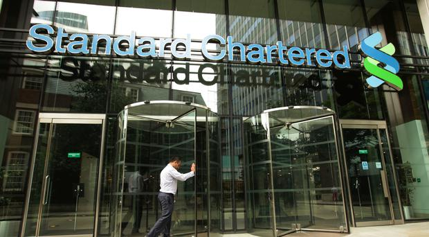 A general view of the Standard Chartered building in the City of London, as bosses agree to cut their pay (Yui Mok / PA)