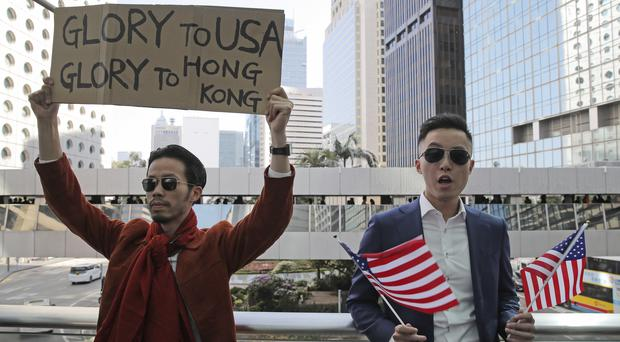 The US and China's relationship has fallen back again after Donald Trump signed legislation supporting Hong Kong protesters (AP/Kin Cheung)