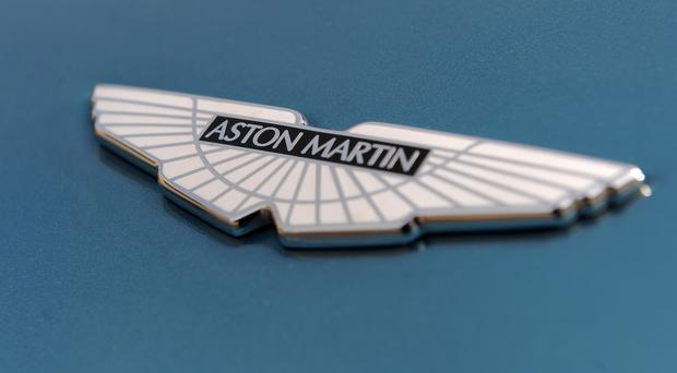 Aston Martin saw shares jump higher after reports billionaire Lawrence Stroll was eyeing a bid for a stake in the company (Joe Giddens/PA)