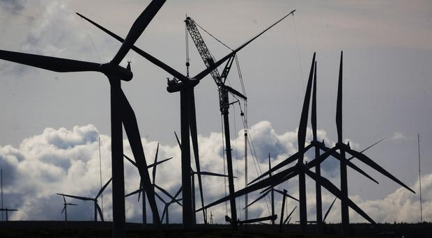 Companies who do not use enough renewables are required to pay an annual fee to support green energy generation (Danny Lawson/PA)
