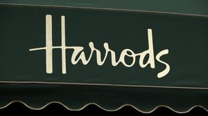 Harrods Bank has been sold to Tandem in a deal which will enable it to regain its banking licence
