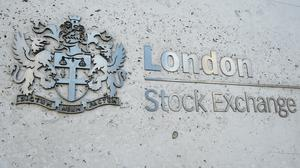 A view of the London Stock Exchange sign in the City of London, as the FTSE 100 Index slumped on Monday (Kirsty O'Connor/PA)