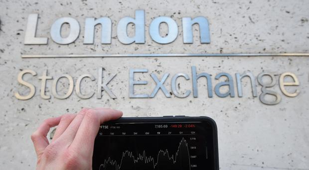 Shares ticked upwards in a quiet day on the market. (Kirsty O'Connor/PA)