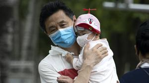 Flights have been cancelled in China over worries of a second wave of infections. (AP Photo/Ng Han Guan)