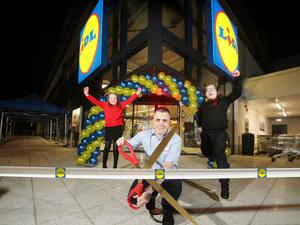 From left, Lily Irvine, Edenbrooke Primary School; Thomas McFarlane, Lidl Northern Ireland Hillview Retail Park store manager; and Pearse Osborne, Holy Cross Boys Primary.