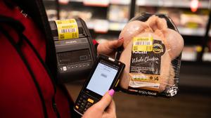 Yellow stickered produce is scanned to the Gander app.