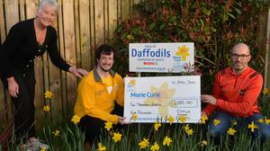 Anne Hannan and Cathal McGurk from Marie Curie are pictured with Martin Daly in the Daly's SPAR Field of Hope. Photo credit: Pat McSorley