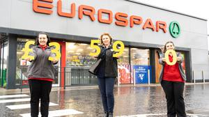 Hannah Harvey from EUROSPAR Moat Street in Donaghadee, Ava Wilkinson from Friends of the Cancer Centre and Megan Crawford from EUROSPAR Hardfordlink in Newtownards.