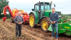 James Kyle, North Antrim potato grower, and Stuart Meredith, Wilson's Country agronomist, inspect a 17-acre field of Maris Piper, planted out in April.