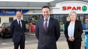 Kevin Paterson, regional manager NI, Brian Donaldson, CEO of The Maxol Group and Val Rodden, licensee of Maxol Eglinton.