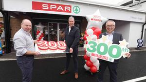 Graham Johnson and Andy Davis, owners of SPAR Coagh, celebrate their store's honour as the 300th SPAR to open in Northern Ireland, with Martin Agnew, joint managing director, Henderson Group.
