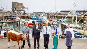 Robert Doyle, Beechmount Farm, with his Irish Moiled cow; David Boyd, commercial director, Rockabill NI; Mayor of Ards and North Down Mark Brooks; Mermaid Rachel Harris (Peter Corry Productions); and Paul Mercer, SERC Deputy Head of School of Hospitality, Management, Tourism and Languages. Photo credit: Paul Moane/AURORA