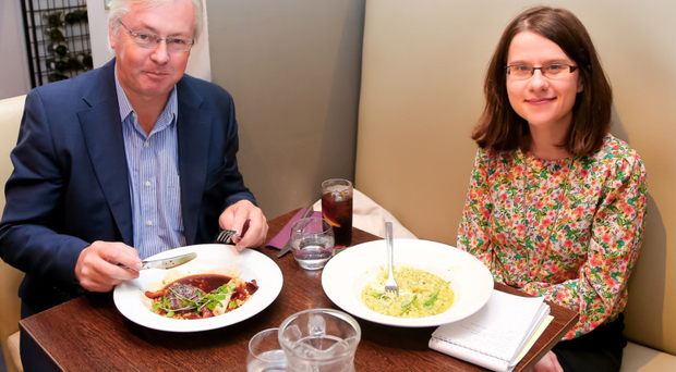 Colin Walsh, tucking into his pigeon, with Margaret Canning