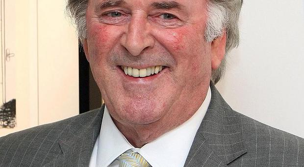 Sir Terry Wogan said he found it difficult to be on British radio during the Troubles