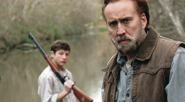 Grim tale: Nicholas Cage (right), with Tye Sheridan, plays an ex-con looking for redemption