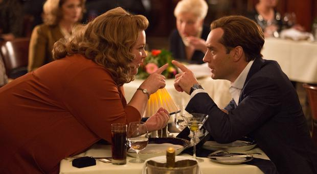 Table manners: Jude Law and Melissa McCarthy