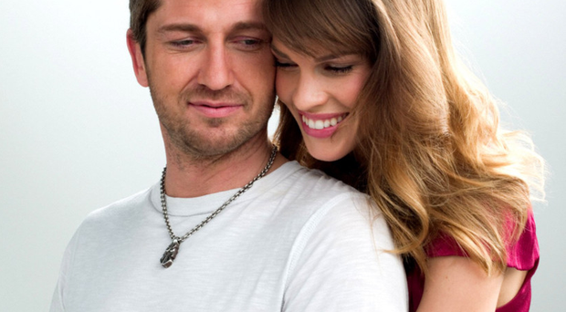 Lost love: Gerard Butler and Hilary Swank in PS I Love You, which inspired Heavenote