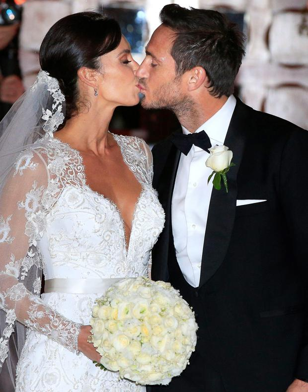 Frank and Christine Lampard emerge from their wedding at St Paul's Church in Knightsbridge, London on Sunday